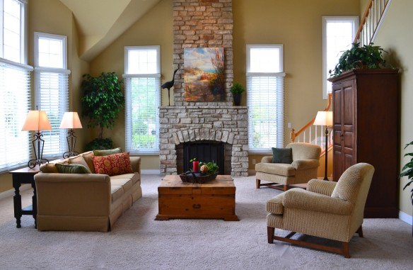 AFTER - Now you can see how spacious the room is and the fireplace focal point.